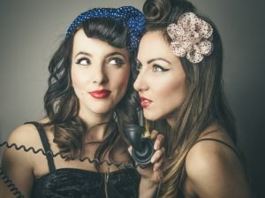 Two girls in vintage clothing pose Bank & Vogue