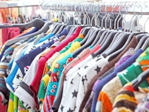 Rack of vintage clothing for sale at thrift store