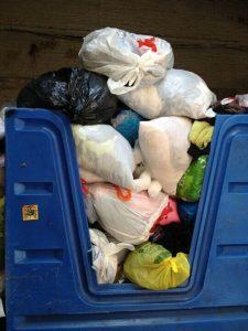Full donation bin of used clothing