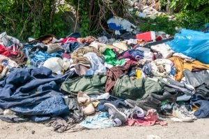 credential clothing in a landfill