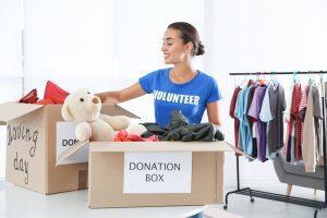 volunteer sorting through donation bin