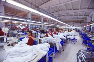 workers assemble clothing in a factory