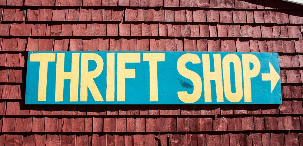 thrift shop sign on side of building