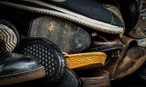 used shoes in a pile