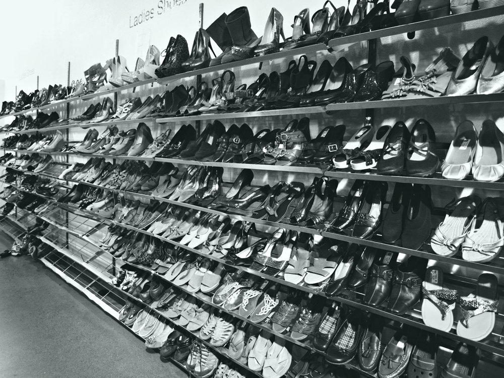 thrift store shelves with used shoes